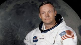 "the ""Apollo 11"" lunar landing mission commander Neil A. Armstrong, posing in his space suit"