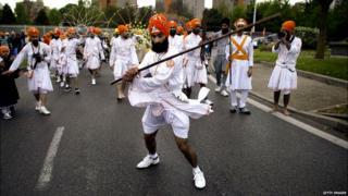 Indian Sikh pilgrims parade on April 13, 2014 in Bobigny, near Paris, during celebrations for Vaisakhi, the Sikh New Year Festival,