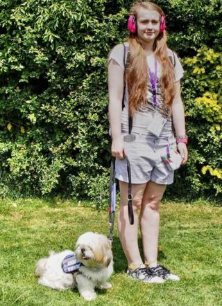 Abby with her assistance dog Chloe