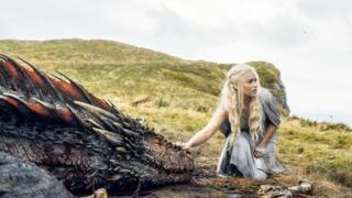 Actress Emilia Clarke appears in a scene from Game of Thrones