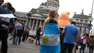 "People gather near the ""Baby Trump"" balloon ahead of the G20 leaders summit, in front of the Congress building in Buenos Aires, Argentina, 29 November"