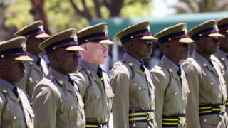 Police officers stand to attention on Thursday during a graduation parade, Harare, Zimbabwe - Thursday 15 November 2018