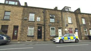 Police vehicles at scene in Parkwood Street, Keighley