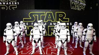 Stormtroopers in front of Star Wars sign