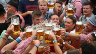 visitors toast with beers
