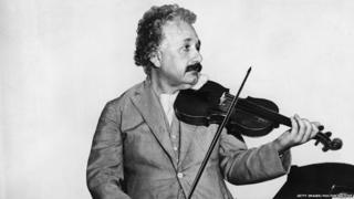 his heavily retouched photograph shows German-Swiss-American mathematical physicist Albert Einstein (1879 - 1955) as he plays a violin in the music room of the S.S. Belgenland en route to California, 1931.