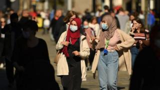 Women wearing masks in Newcastle