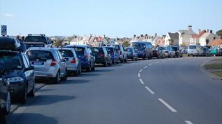 Cars parked along the Guernsey east coast to watch the 2012 Air Display