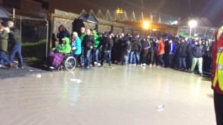 Fans faced flooding as they tried to enter and leave Windsor Park