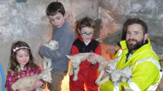 Shannon family with lambs