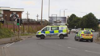 Police van and car outside Shettleston Juniors football ground