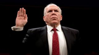 Image shows Former CIA director John Brennan being sworn in to testify in Congress