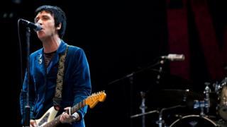 Johnny Marr playing at Glastonbury
