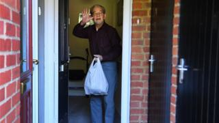 Covid 19  Corona Virus An elderly man receives urgent food supplies from Bucks Angels C-19 Community Group in High Wycombe, Buckinghamshire, Britain, 25 April, 2020.