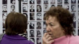 Activists of Chilean Human Rights organization 'Detained and Disappeared People' participate in a ceremony at Villa Grimaldi, which was used as a detention and torture centre during the dictatorship (1973-1990) of Augusto Pinochet, in Santiago, on September 10, 2013.