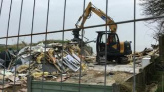 Remains of demolished chalet