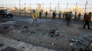 Security forces clear the site of the bombing