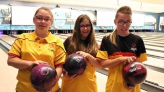 The Delaney sisters holding bowling balls.