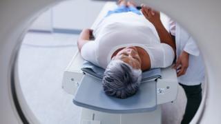 woman going through MRI machine