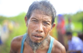 An exhausted Rohingya man whose eyes have witnessed deadly atrocities