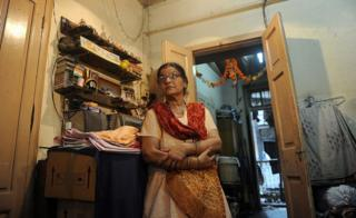 Smita Panvalkar stands inside her apartment in the Pathare Prabhu building, due to be demolished to make way for a luxury apartment building, in Mumbai on June 24, 2011.