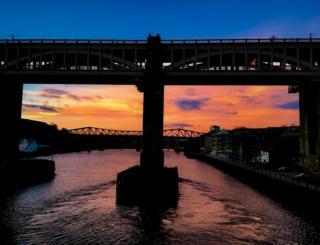 Bridge silhouetted at sunrise