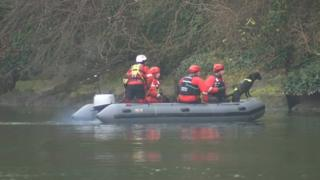 Rescue team searching the river