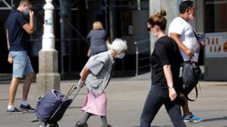 People wearing masks walk in Zagreb, Croatia. Photo: September 2020