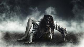 Вылезающий из могилы мертвец