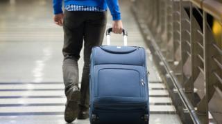 sports Man dragging suitcase