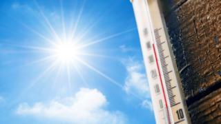 temperature gauge and sun