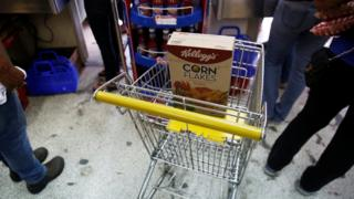 A box of Kellogg's Corn Flakes on a shopping trolley inside a shop in Caracas, Venezuela May 15, 2018