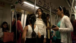 Indian commuters travel in the compartment reserved for women on the metro in New Delhi, India, on June 10, 2015