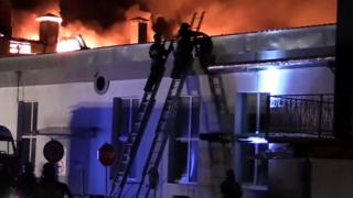 A still image taken from video footage and released by the Russian Emergencies Ministry on 23 September 2016 shows firefighters battling a blaze at a plastics warehouse in Moscow, Russia