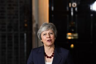 Theresa May talking to the media in front of 10 Downing Street