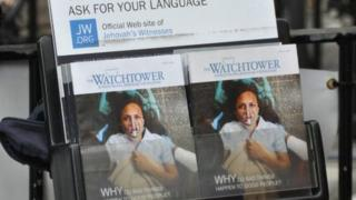 A leaflet stand showing copies of the Watchtower