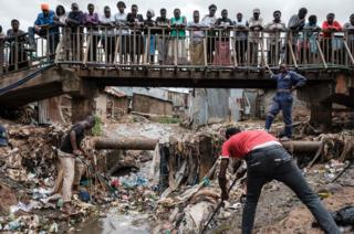 Volunteer clean the drainage during the community cleanup event supported by UN Environment at Kibera slum in Naiorbi, Kenya, on Africa day which commemorates the founding of the Organisation of African Unity (OAU now the AU), on May 25, 2018