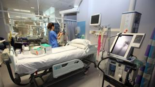 Staff prepare equipment in the Critical Care Unit of the new Queen Elizabeth super hospital