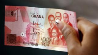 Pesin dey hold Ghana Cedi