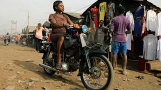 A woman rides a motorbike at Wurukum Market in Benue, Nigeria -Wednesday 11 April 2018
