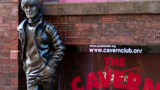 A statue of John Lennon outside of The Cavern Club in Liverpool