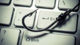 Fishing hook on a computer keyboard