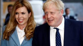 Boris Johnson and his girlfriend Carrie Symonds arrive at the hotel before the Conservative Party's annual conference in Manchester, September 28, 2019.