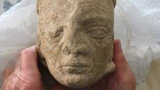 stone head of monk