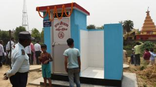 Toilet being hoisted into position