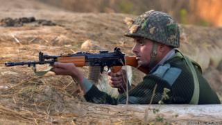 An Indian army soldier takes up position on the perimeter of an airforce base in Pathankot on January 3, 2016.