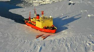 """The crew of the ARA Almirante Irizar draw the number """"44"""" into the ice."""