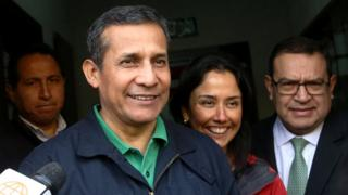 Peru's former President Ollanta Humala and his wife, Nadine Heredia, leaving the Nationalist Party headquarters in Lima on Thursday, while smiling broadly