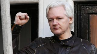Julian Assange speaks on the balcony of the Embassy of Ecuador in London on May 19, 2017