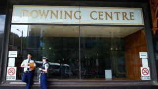 File photo: Two police officers in front of the Downing Centre local courts in Sydney